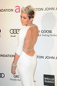 LOS ANGELES - FEB 24:  Miley Cyrus arrives at the Elton John Aids Foundation 21st Academy Awards Vie