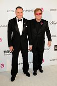 LOS ANGELES - FEB 24:  David Furnish, Elton John arrive at the Elton John Aids Foundation 21st Acade