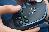 Closeup of male hands with gamepad game controller