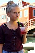 Cute Girl With Red Slush Drink