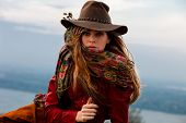 young blond woman in autumn fashion clothes,  red leather jacket, hat, cashmere scarf and brown skir