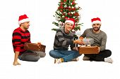 Cheerful Friends Guys Sharing Gifts