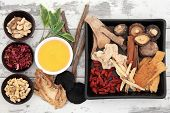 stock photo of qi  - Traditional chinese herbal medicine ingredient selection with honey - JPG