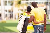 rear view of young african couple looking at modern apartment before buying
