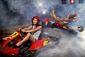 image of karts  - girl is driving Go - JPG