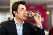 Man tasting a white wine