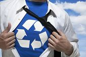 Businessman with open short revealing shirt with recycling symbol underneath