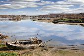 Old Beached Fishing Boat On Irish Beach