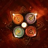 stock photo of pooja  - A group of decorative Indian lamps - JPG
