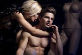 stock photo of nude couple  - Sexy young beauty couple in night club - JPG