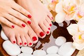 image of pedicure  - Closeup photo of a beautiful female feet at spa salon on pedicure procedure - JPG