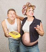 Pregnant Woman Grabbing Man
