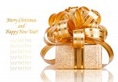 Beautiful  Gift Box In Gold Wrapping Paper Isolated On A White Background