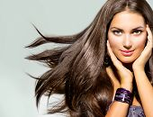 image of hair blowing  - Beautiful Woman with Long Brown Hair - JPG