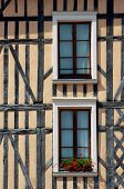 stock photo of tenement  - windows in tenement house in the old city of Troyes France - JPG