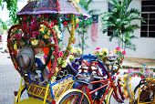 stock photo of malacca  - Colorful trishaw decorated with flowers at Malacca - JPG