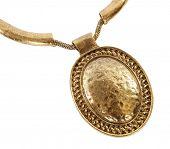 Golden medallion on necklace