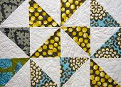 stock photo of quilt  - Close up of an old patchwork quilt - JPG