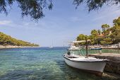 Boats in a tranquil coast lagoon at a beach on Hvar Island, Croatia