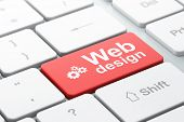 Web development concept: Gears and Web Design on computer keyboa