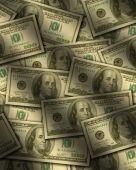 One Hundred Dollar Bills Lying Flat