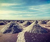 image of salt mine  - Vintage retro hipster style travel image of salt mine at Sambhar Lake - JPG