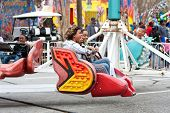 Women Laugh Riding Scrambler Carnival Ride
