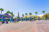 People Visit Disneyland And Walk Over Commemorative Bricks With Names In Terracotta
