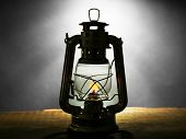 stock photo of kerosene lamp  - Kerosene lamp on dark grey background - JPG