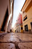 stock photo of cobblestone  - A small pretty street wtih cobblestone in Rab - JPG