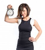 Pretty Woman Holding An Antique Clock Over White Background