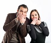 Couple Doing Surprise Gesture Over White Background