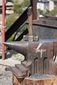 stock photo of anvil  - The photo shows blacksmith tools  - JPG