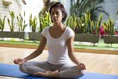 Attractive Woman Practices Yoga