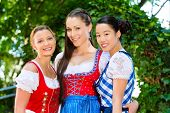 female friends in Tracht, and Dirndl in Bavaria, Germany