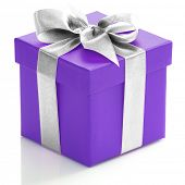 Single purple gift box with silver ribbon on white background.