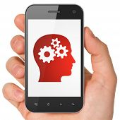 Marketing concept: Head With Gears on smartphone