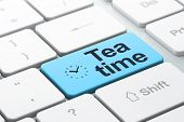 Time concept: Clock and Tea Time on computer keyboard background