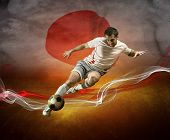 Abstract waves aroun soccer player on the national flag of Japan