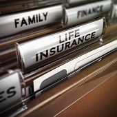 foto of policy  - Close up on a file tab with the word life insurance focus on the main text and blur effect - JPG