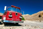 DEATH VALLEY, USA - 11 MAY, 2007: Old fire truck located in the desert in Death valley. Situated wit