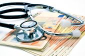 a stethoscope on a pile of euro bills, depicting the health care industry concept