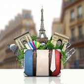 France and attractions of Paris, retro suitcase