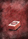 Grunge abstract design background with mahjong tile from ancient chinese game