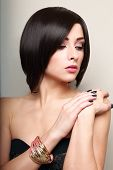 Beautiful Makeup Short Black Hair Woman With Bangle On The Hand