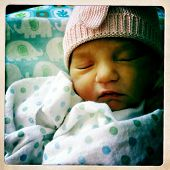 Instagram style portrait image of a newborn one day old infant
