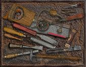 vintage woodworking tools over rusty industrial metal plate