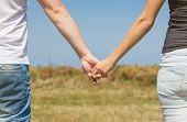 Close up of couple holding hands outdoors