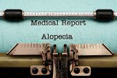 picture of alopecia  - Close up of Alopecia text on typewriter - JPG