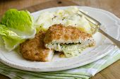 image of kiev  - Chicken kievs with mashed potatoes and lettuce